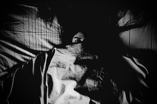 Girl in bed alone